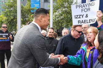 Israel Folau meets with supporters on his way into Melbourne's Federal Circuit Court this week.