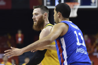 Aron Baynes of Australia looks to pass around Eloy Vargas of the Dominican Republic.