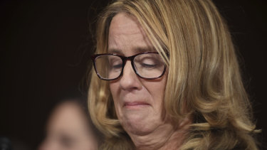 Christine Blasey Ford holds back tears as she testifies to the US Senate about an alleged assault by Supreme Court nominee Brett Kavanaugh.