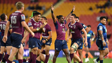 Red alert: The Queensland Reds celebrate the end of their drought against New Zealand teams.
