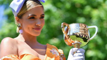 Positive step ... Olivia Molly Rogers, the Victoria Racing Club ambassador, with the Melbourne Cup at Monday's launch.