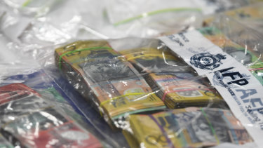 Seized drugs and money are displayed at the Australian Federal Police headquarters in Melbourne on Wednesday.