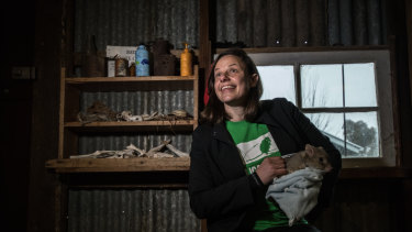 Ecologist Kate Grarock with Brian the bettong.