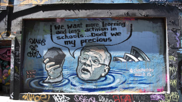 A mural in Melbourne depicting Prime Minister Scott Morrison in a flooded Sydney Harbour holding a lump of coal.