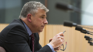 7-Eleven chief executive Angus McKay gives evidence at the inquiry.