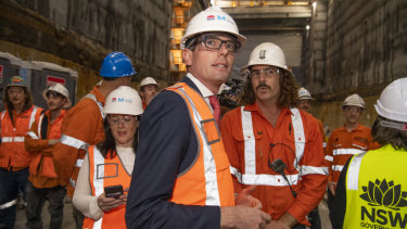 NSW Treasurer Dominic Perrottet with Sydney Metro workers on Thursday.