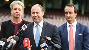 Bridget McKenzie, Josh Frydenberg and Dave Sharma during an announcement at the Sydney Cricket Ground.