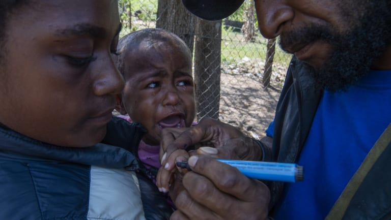 One-year-old Wanita receives a Polio vaccination.