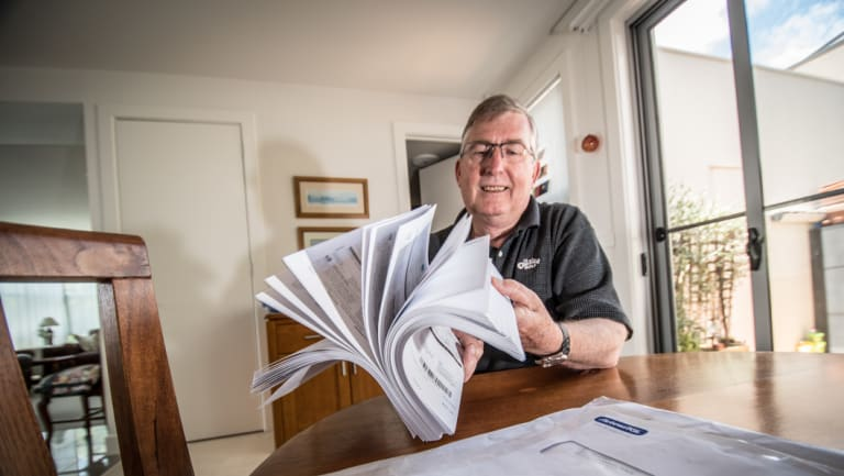Belconnen resident John Steep, pictured, received a parcel of hundreds of ActewAGL bills on Wednesday.
