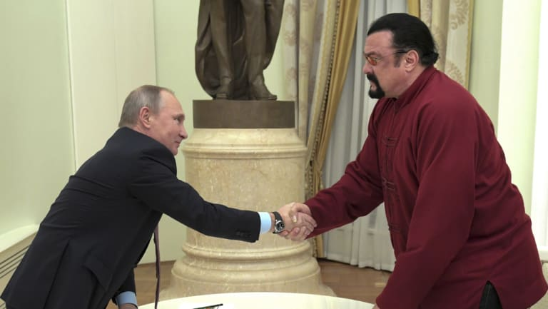 Russian President Vladimir Putin shakes hands with US actor Steven Seagal in the Kremlin in Moscow on November 25, 2016.