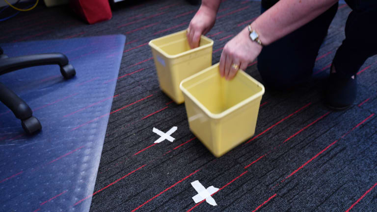 X marks the spot. Masking tape reveals where buckets need to be positioned when it rains