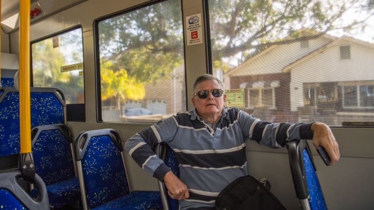 Breakfast Point retiree Michael Ward tries an on-demand bus for the first time.