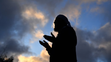 Mufti Zeeyad Ravat leads a prayer at a makeshift memorial at the Al Noor Mosque in Christchurch.
