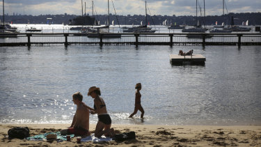 Bathers enjoy warm late autumn weather at Red Leaf Beach in Double Bay, Sydney.