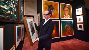 Art consultant Mark Fraser with some of Sidney Nolan's paintings from the estate of his widow Mary Nolan, which will go to auction on June 26.