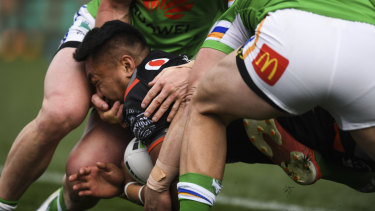 Footage shows Hudson Young of the Raiders with his hand in the face of Adam Pompey.