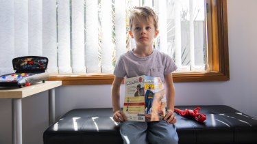 Mary Gabbey's son Henry likes the variety of topics he can explore on weekly visits to the library.