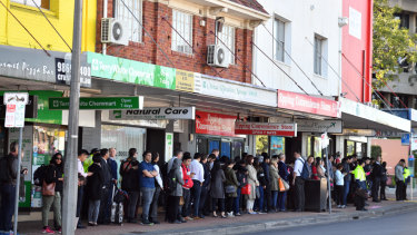Commuters queue for replacement buses near Epping train station on Tuesday morning.