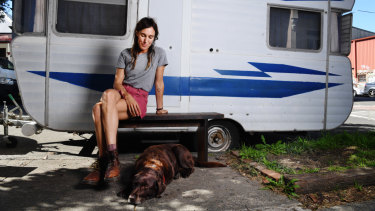 """Holly Throsby, wearing what she describes as her """"galah"""" colour palette, and her dog Jones in Marrickville."""