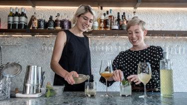 Caitlin Baker, left, and Dash Rumble at Pilot restaurant.