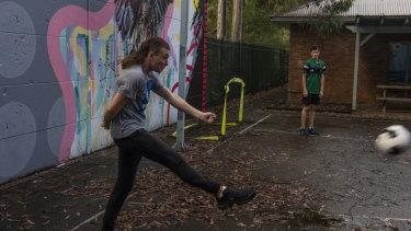Cody, 17, kicking the ball at the Aboriginal program in Wyoming.