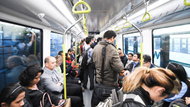 Passengers on a driverless train on the Metro Northwest line between Rouse Hill and Chatswood.