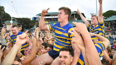 Uni's Guy Porter celebrates after Sydney University won the Shute Shield for the first time in five years.