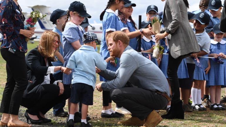 Prince Harry, the Duke of Sussex has his beard tickled by school student Luke Vincent of Buninyong Public School.
