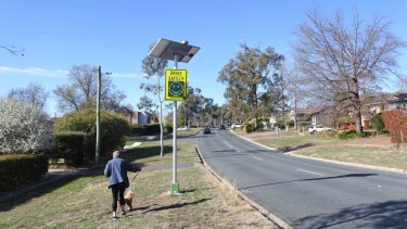 Some people in the Deakin street think the new signs are an eyesore and don't discourage motorists from speeding.