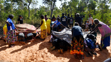 Gumatj women perform a smoking ceremony at the Youth Forum during the Garma Festival.