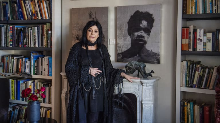 Gallerist Gene Sherman at her Woollahra home with art by Brook Andrew and Olive Richmond.