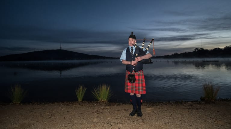 The sound of bagpipes serenaded swimmers as they plunged nude into Lake Burley Griffin for a charity dip on Thursday morning.