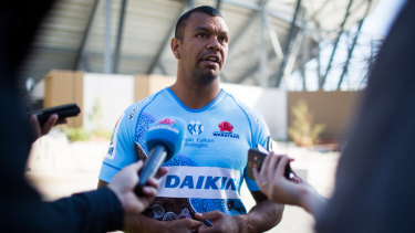 Tribute: Kurtley Beale models the Waratahs' first Indigenous jersey, which they wore in their loss to the Sunwolves.
