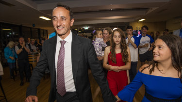 Dave Sharma and his family as results came in on Saturday night.