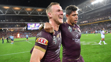 Brothers-in-arms: Daly Cherry-Evans celebrates with Dane Gagai.
