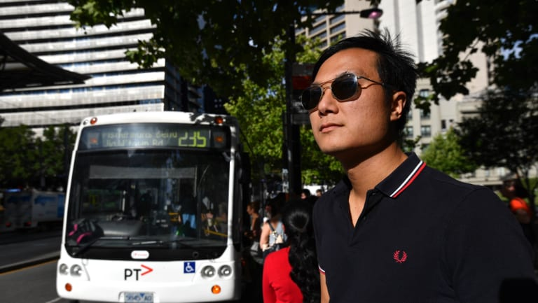 Passengers board the 235 while Toby Chan waits for the delayed 232 bus outside Southern Cross station.