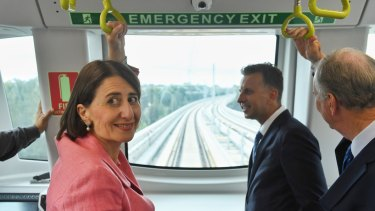 Premier Gladys Berejiklian and Andrew Constance on a driverless metro train undergoing testing in March.