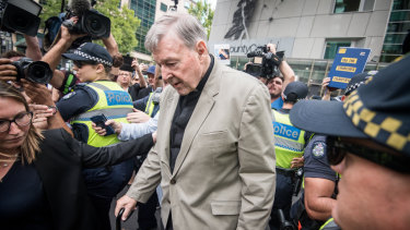 Cardinal George Pell leaving the County Court in Melbourne.