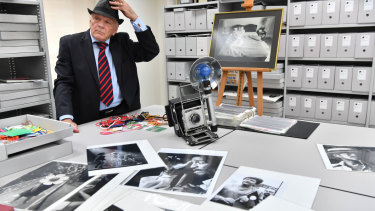 Legendary Age photographer Bruce Postle with photographs and other memorabilia.