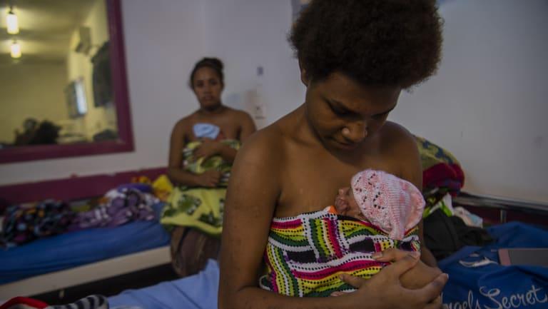 Young mothers Sula Savya (at front), 16, and Lamancha dKalau, 20, with their babies.