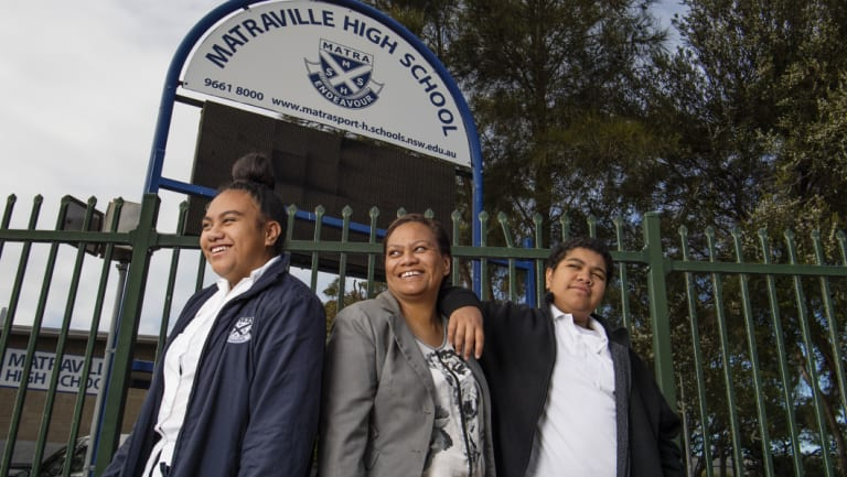 Maria Kaivananga with her daughter Faith and son Genesis outside Matraville Sports High School.