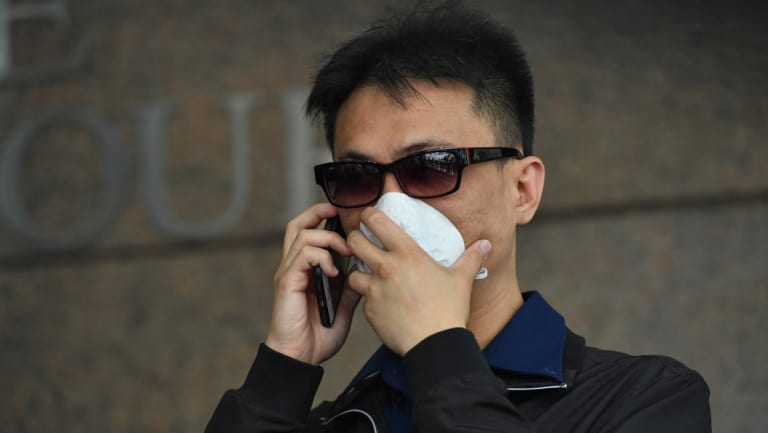 A former dealer at Crown, Michael Hou, has been charged over an alleged card con at the casino.