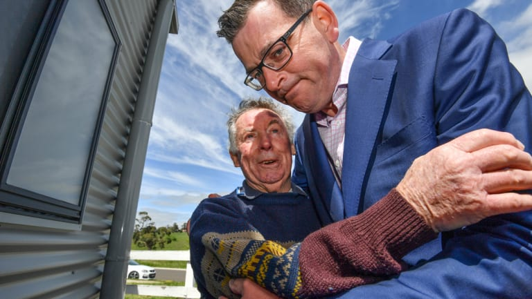 Daniel Andrews with Bob Grubb, whose grandson Anthony died when he was hit by a train.