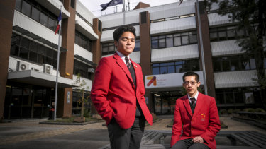 Vietnamese international student An Hoang (left) and Chinese student Jian Kun Zheng say Auburn High School has given them plenty of opportunities