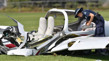 Police look over the wreckage at the scene of the light aircraft crash at Allenview on September 26, 2017.