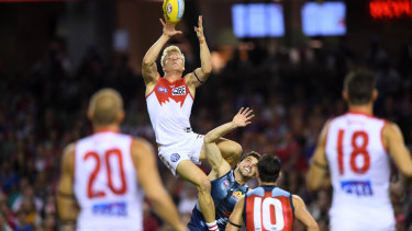 Isaac Heeney climbs high to take a spectacular mark with his first touch of the season.