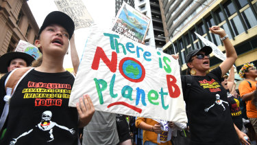 School students take part in the climate change strike in Brisbane.