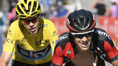 Richie Porte rides ahead of former teammate Chris Froome.