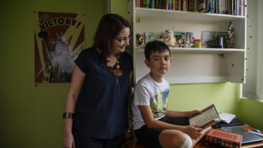 After intensive tutoring, Declan Peno is able to read to his mother Julie.