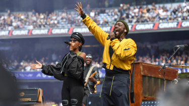 The Black Eyed Peas perform at the AFL grand final.